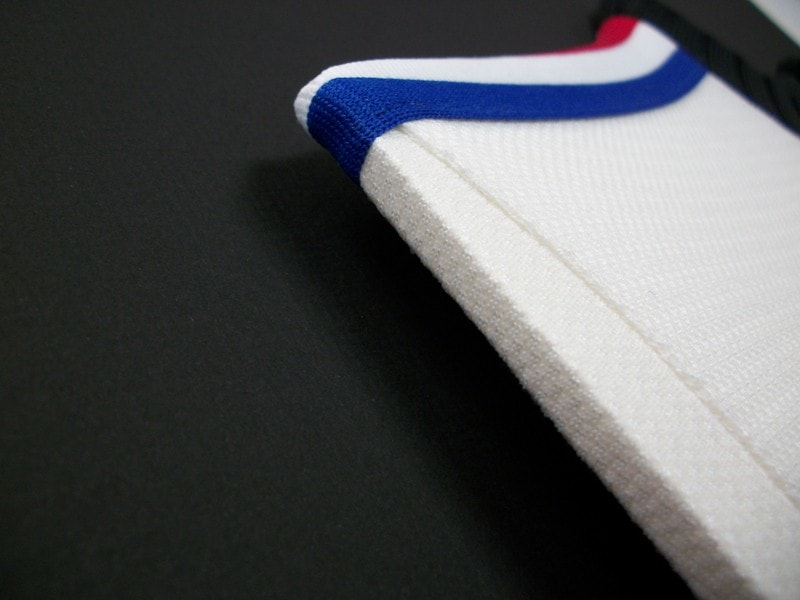 Shirts are stretched over Archival Foam Board to prevent any damage.