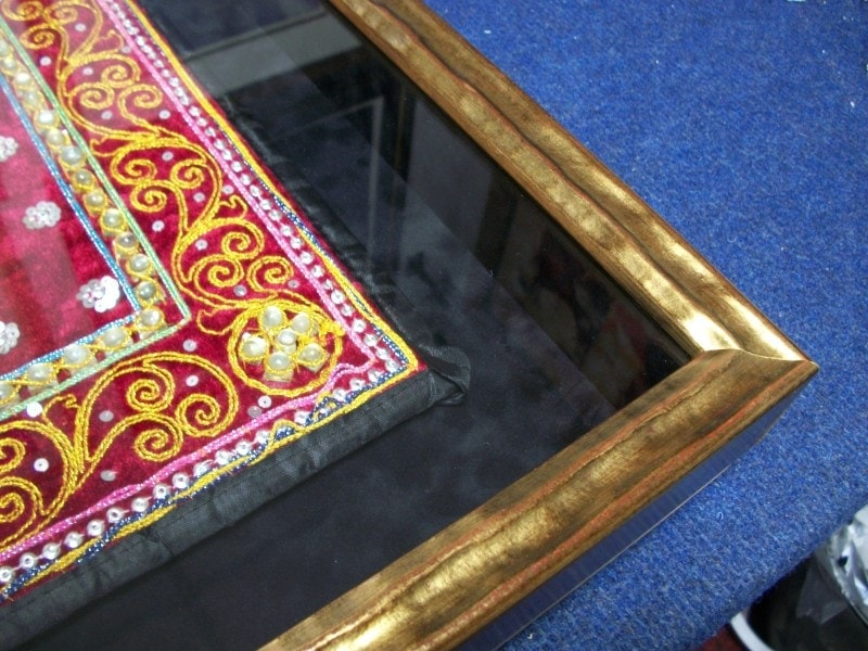 A velvet effect, lined box frame..