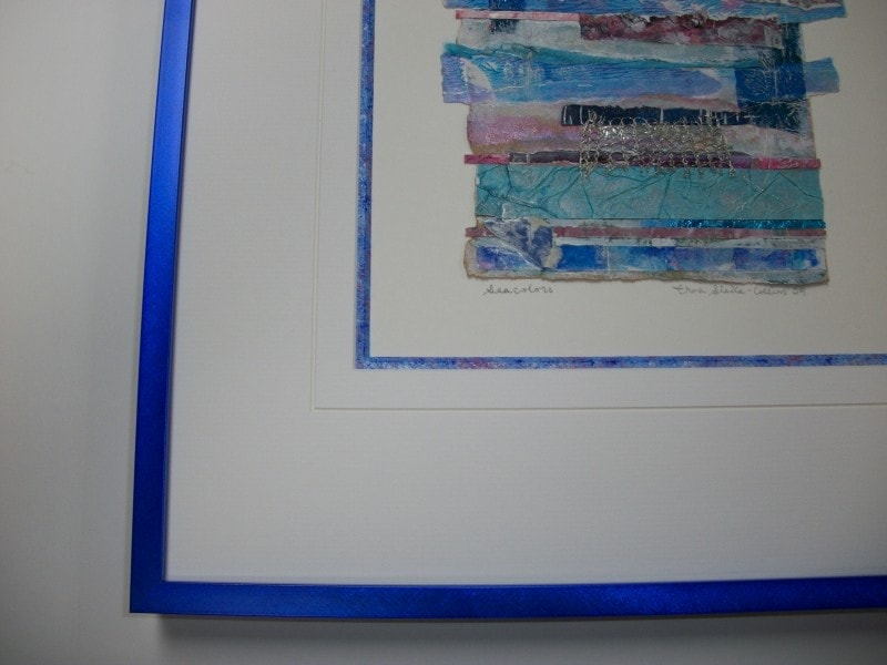 The handpainted bevel complements this mixed media art