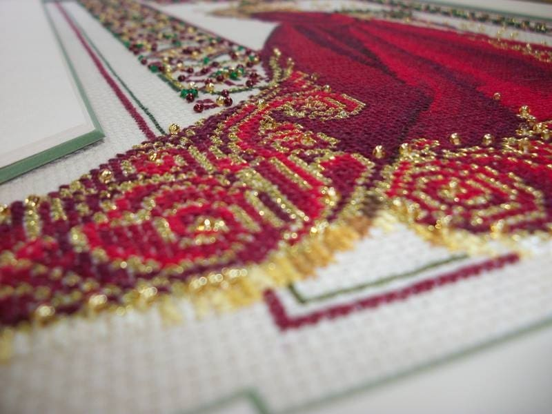 Here's a closeup photo of the detailed fabricwork