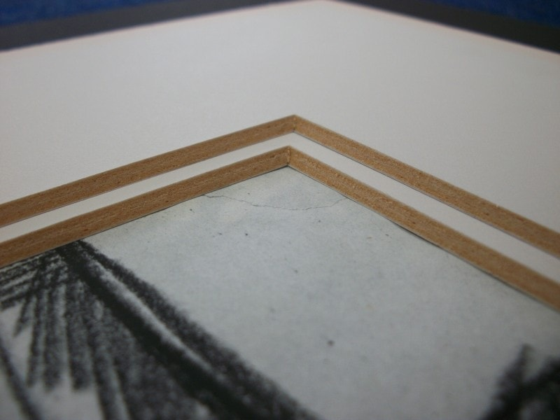Cheap mountboard will damage your artwork