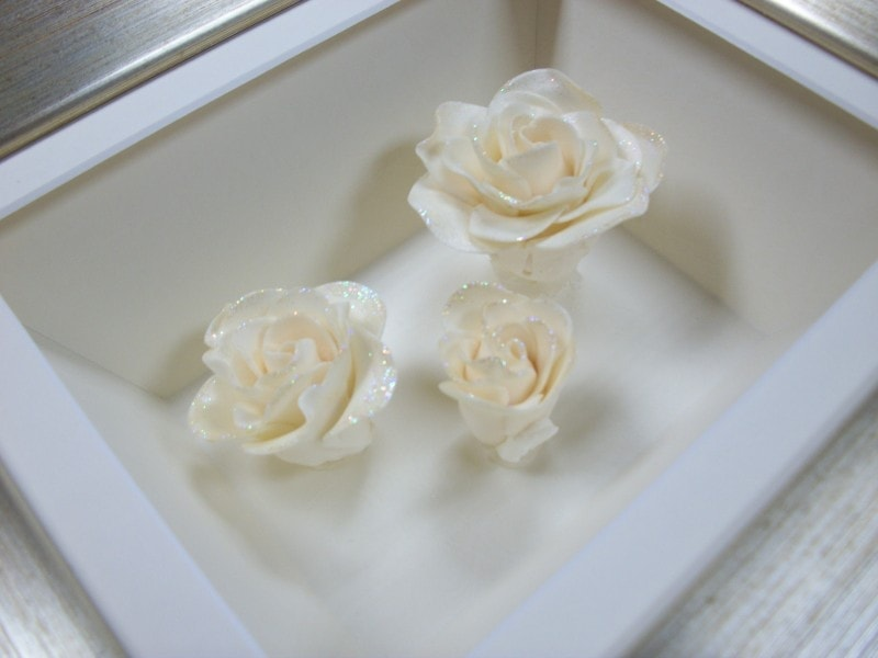 Sugar flowers in a really deep, shaped box frame